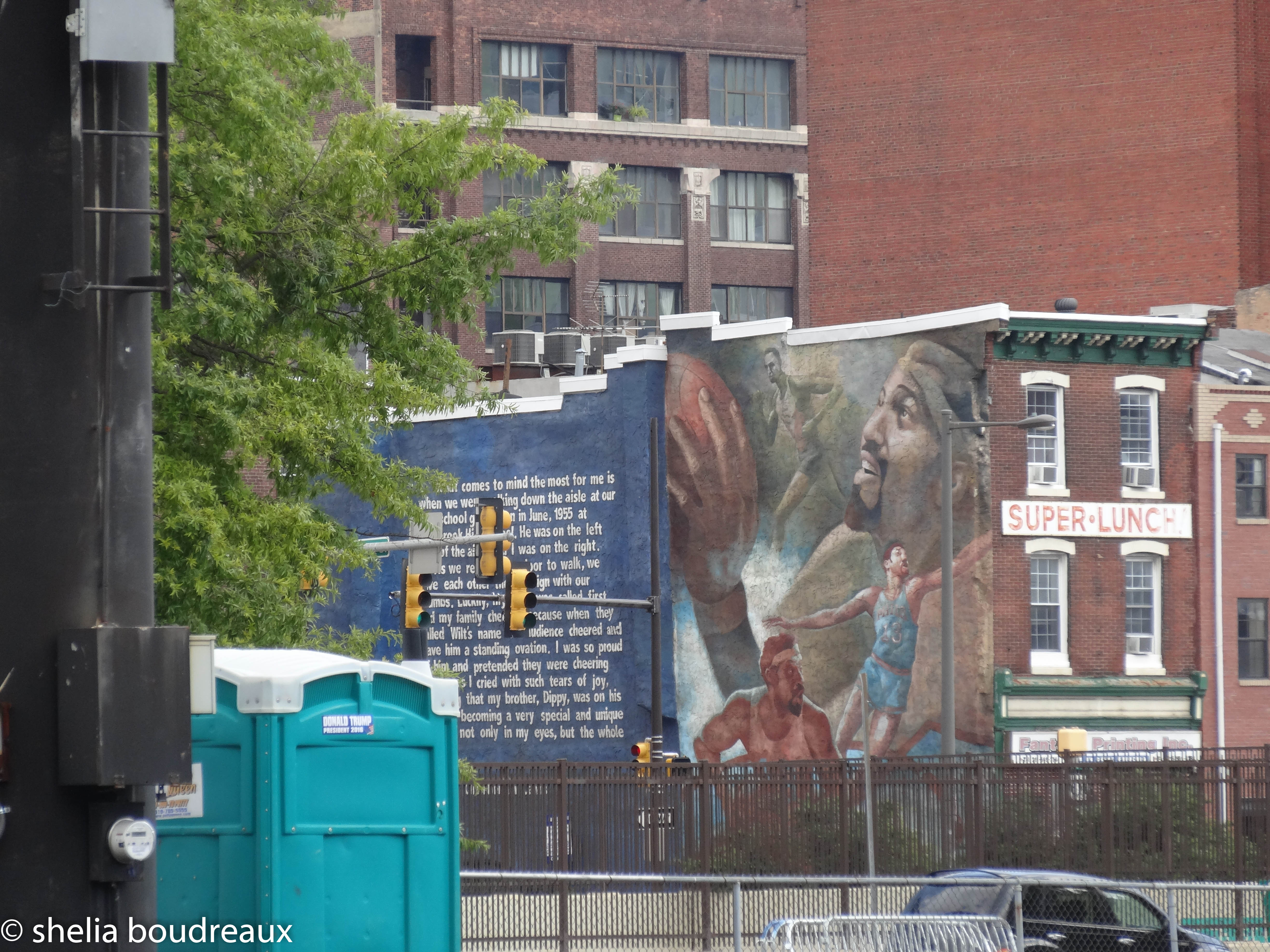 Philadelphia Mural Tour by John Lewis featuring the Philadelphia-born basketball star is on the side of Frank's Place